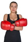 Woman in boxing gloves with her hands crossed on Stock Photo