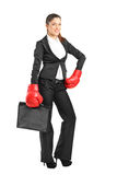 Woman with boxing gloves holding a briefcase Royalty Free Stock Photo