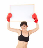 Woman in boxing gloves keeping blank poster Stock Photo