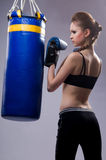 The woman in boxing gloves and pears Royalty Free Stock Image