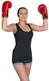 Woman in boxing gloves posing with her arms up Stock Photos