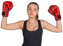 Woman in boxing gloves posing with her arms up Stock Image
