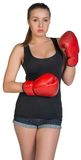 Woman in boxing gloves posing Royalty Free Stock Photography