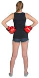 Woman in boxing gloves standing akimbo Royalty Free Stock Photography