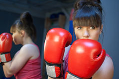 Woman boxing in gym. Boxing and working out in gym Royalty Free Stock Photography