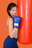 The woman with a boxing pear Royalty Free Stock Photography