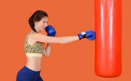 The woman with a boxing pear Stock Image