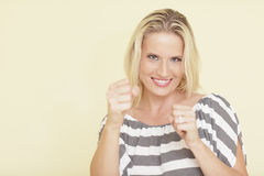 Woman in a boxing pose Royalty Free Stock Images