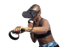 Woman Boxing in VR with a Virtual Reality Headset and Controllers stock photography