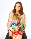 Woman and boy checking christmas presents Royalty Free Stock Photography