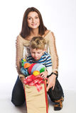 Woman and boy checking christmas presents Stock Image