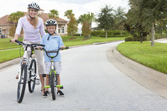 Woman and Boy Child, Mother & Son Cycling Stock Photo
