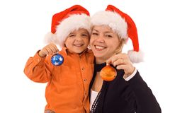 Woman and boy with christmas baubles - isolated Stock Image