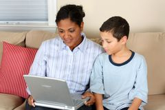 Woman and Boy On Computer Royalty Free Stock Photos
