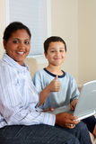 Woman and Boy On Computer Royalty Free Stock Photography