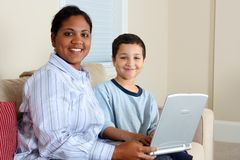 Woman and Boy On Computer Royalty Free Stock Image