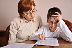 Woman and boy doing homework Royalty Free Stock Photography
