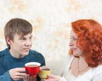 Woman and  boy drink tea Stock Images