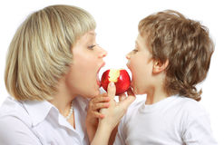 Woman and boy eating apple Stock Photo