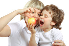 Woman and boy eating apple Royalty Free Stock Photography