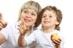 Woman and boy eating apple Royalty Free Stock Photos