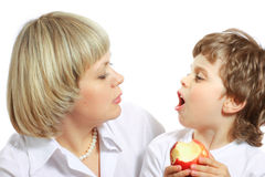 Woman and boy eating apple Royalty Free Stock Photo