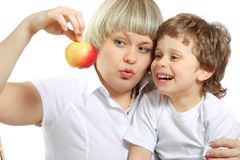 Woman and boy eating apple Royalty Free Stock Images