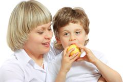 Woman and boy eating apple Royalty Free Stock Image