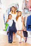 Woman with boy and girl stand close while shopping Stock Photography