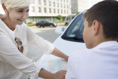 A woman and a boy with map stock photos