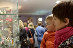 Woman and boy in museum Stock Photos