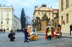 Woman and boy observe staging warrior with sword at gates of Prague Castle, Prague, Czech Republic royalty free stock photo