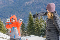 Woman and boy over winter mountains background. Happy beautiful Stock Photos