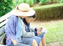 Woman With a Boy Sits on Bench stock image