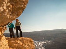 Woman with a boy standing on a rock royalty free stock photography