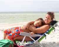 Woman with boy on a sun chair Stock Photo