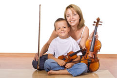Woman and boy with violins Stock Images