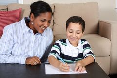 Woman and Boy Writing Royalty Free Stock Images