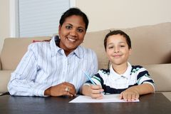Woman and Boy Writing Stock Photos