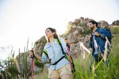 Woman and boyfriend on mountain vacation Stock Photos