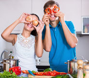 Woman and boyfriend preparing vegetables. Woman and boyfriend preparing  vegetables at kitchen table Stock Images