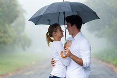 Woman boyfriend umbrella Stock Photos