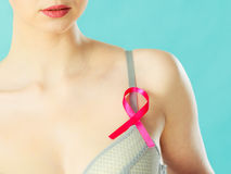 Woman in bra with breast cancer awareness ribbon Stock Photos