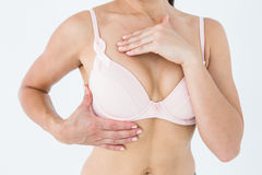 Woman in bra with breast cancer awareness ribbon Stock Images