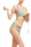 Woman in bra lingerie measuring her chest breasts. Royalty Free Stock Photography