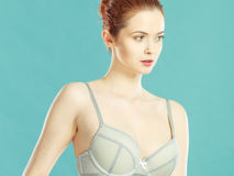 Woman in bra lingerie taking care of her breasts Stock Images