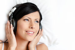 Woman in bra listens to music Royalty Free Stock Images