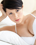 Woman in bra is lying in the bed Royalty Free Stock Photography