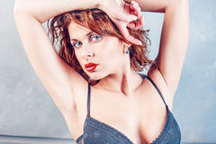 Woman in bra with red lips. Sexy girl with red lips Royalty Free Stock Photography