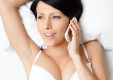 Woman in bra speaks on phone Royalty Free Stock Photo